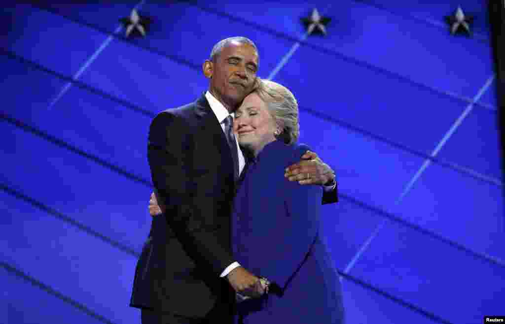 Democratic presidential nominee Hillary Clinton hugs U.S. President Barack Obama as she arrives onstage at the end of his speech on the third night of the 2016 Democratic National Convention in Philadelphia on July 27. (Reuters/Jim Young)
