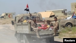 Fotografi e djeshme e pjesëtarëve të ushtrisë së Irakut afër qytetit Falluxhës
