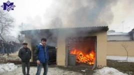 Protesters set fire to a house