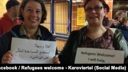 Активисты гамбургской группы Refugees Welcome приветствуют беженцев