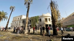 Pamje pas një eksplodimi të mëparshëm në qytetin Bengazi në Libi