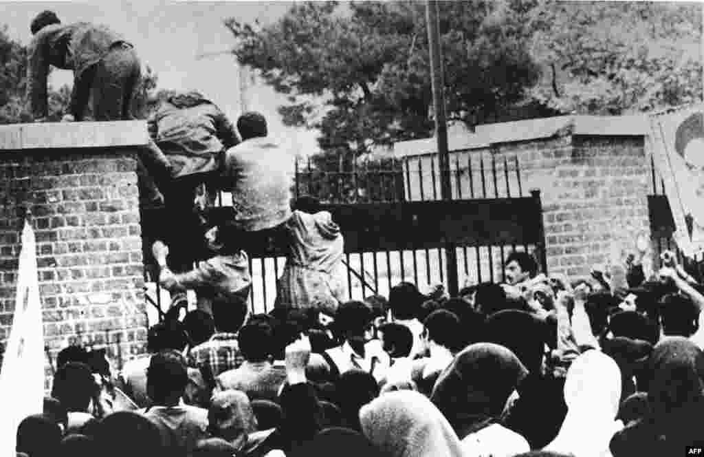 Several hundred young Iranians, supported by a crowd of more than 3,000, climb the walls of the U.S. Embassy at 10:30 a.m. on November 4, 1979. They blindfolded and handcuffed dozens of U.S. citizens they found inside. Protesters had seized the Tehran compound months before, capturing a U.S. Marine on February 14, but order was restored after several hours.