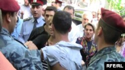 Armenian police detain an opposition supporter near Yerevan's Liberty Square.