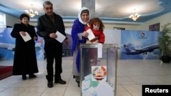 People line up to cast their votes during Tajik parliamentary elections in Dushanbe on March 1.