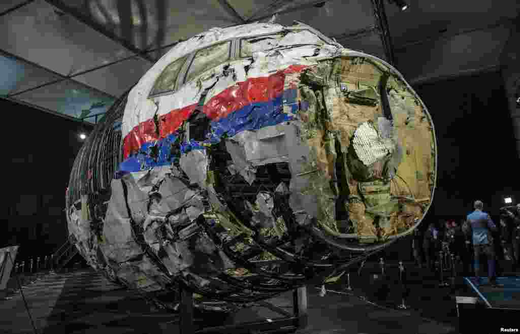 The reconstructed wreckage of Malaysia Airlines flight MH17 is seen after the presentation of the final report into the crash at the Gilze-Rijen Air Force base in the Netherlands. The plane was shot down over eastern Ukraine by a Russian-made Buk missile, the Dutch Safety Board said, killing all 298 aboard. (Reuters/Michael Kooren)
