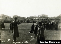 Wrangel (saluting) oversees a military parade in Gallipoli.