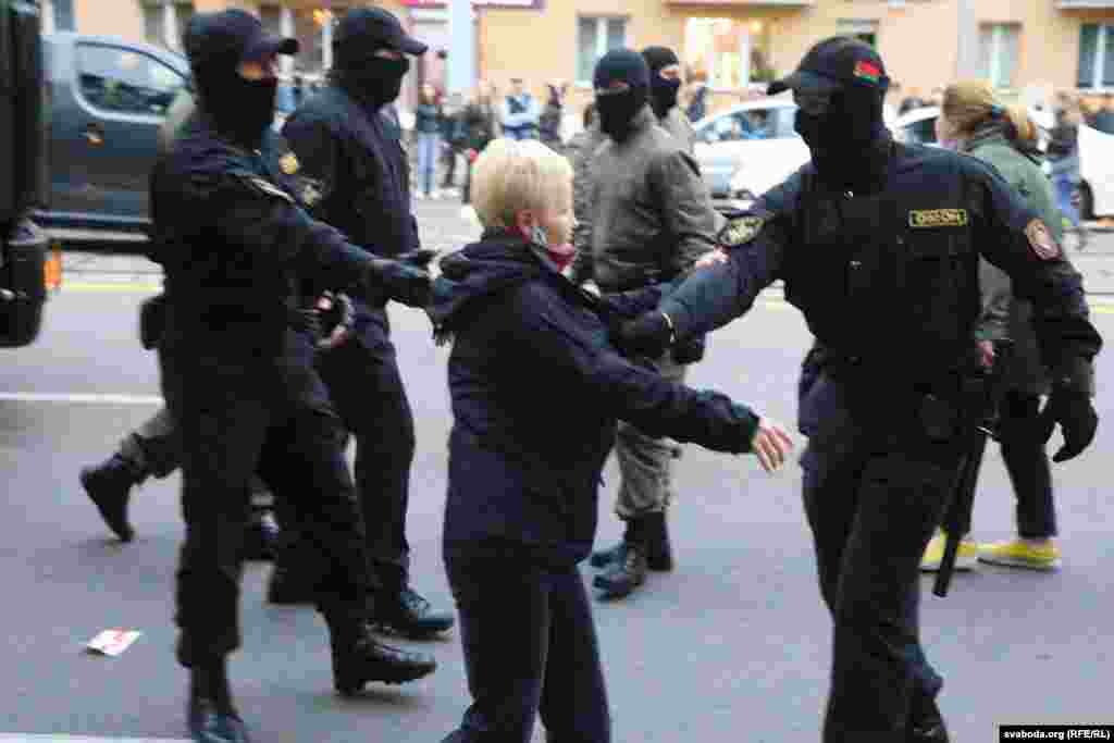 Police detain a woman following the rally in Minsk on September 8.