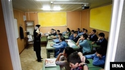 An elementary school classroom in Iran, undated.