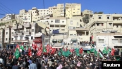 Protesters from opposition parties shout slogans against the government at a demonstration January 21.