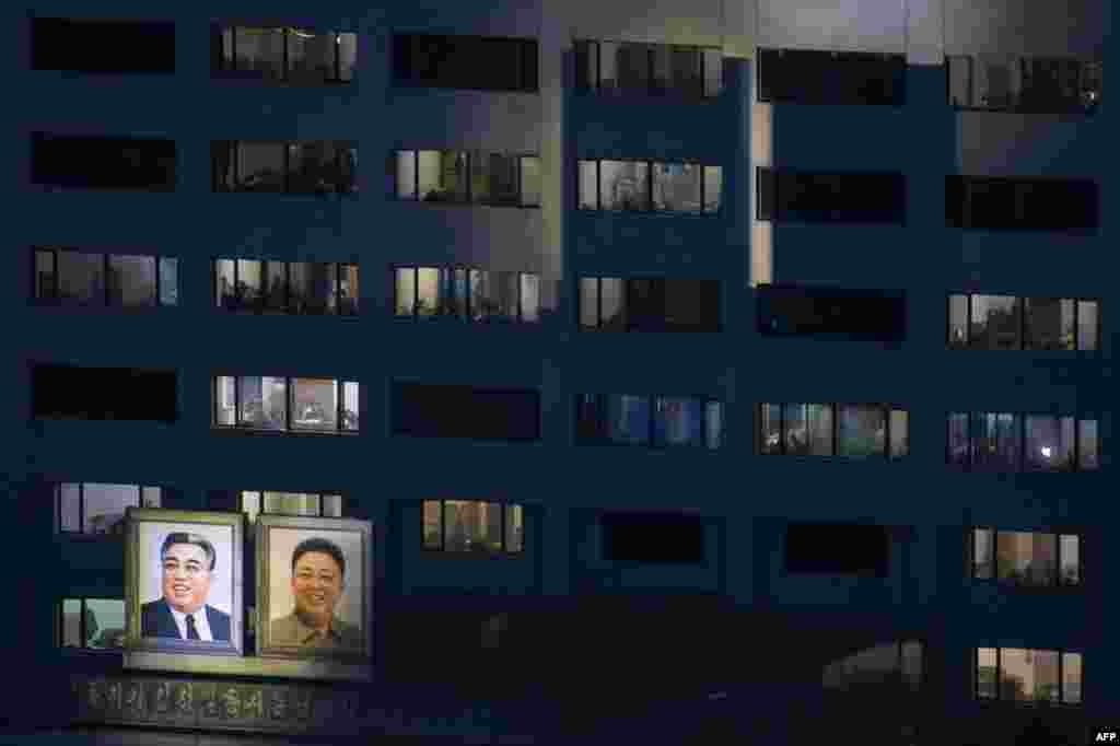 Portraits of late North Korean leaders Kim Il Sung (left) and Kim Jong Il are displayed on the side of a building in Pyongyang. (AFP/Ed Jones)