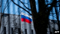 The Russian flag flies outside the Russian Embassy in Washington, D.C.