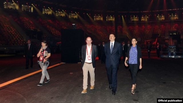 President Ilham Aliyev (second from right) and his wife, Mehriban (right), attend the opening of the Crystal Hall.