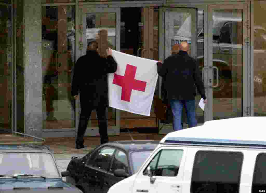 Representatives of the Red Cross gain access to the theater on October 25.
