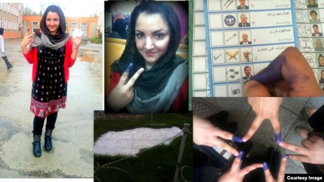 Kabul--Rabia, a young Afghan woman who voted in the April 5 presidential election, shows off her inked finger.