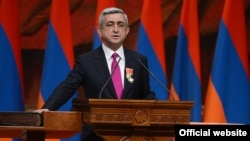Armenia - President Serzh Sarkisian is holding his right hand on the Bible and the Constitution during his inauguration, Yerevan,09Apr2013