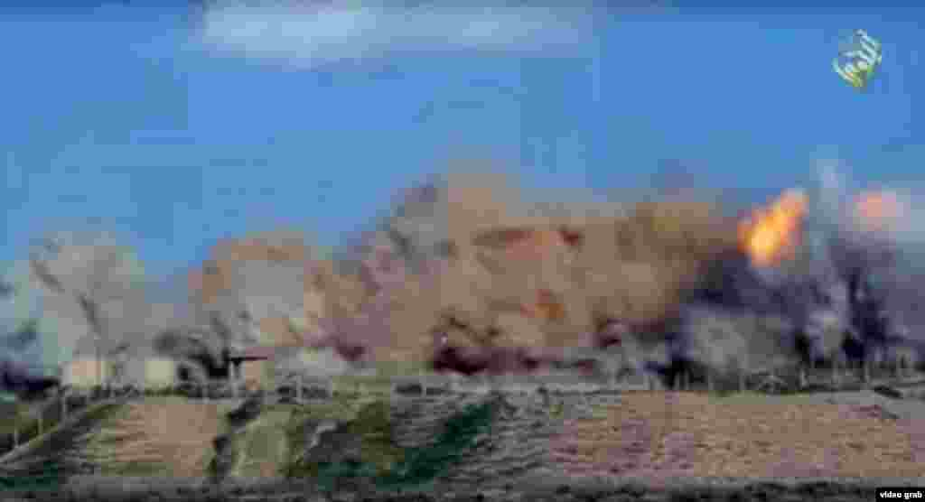 A still from video posted on social media purports to show militants' destruction of parts of Nimrud.