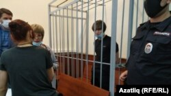Moscow State University postgraduate student Azat Miftakhov appears in court in Moscow on July 23.