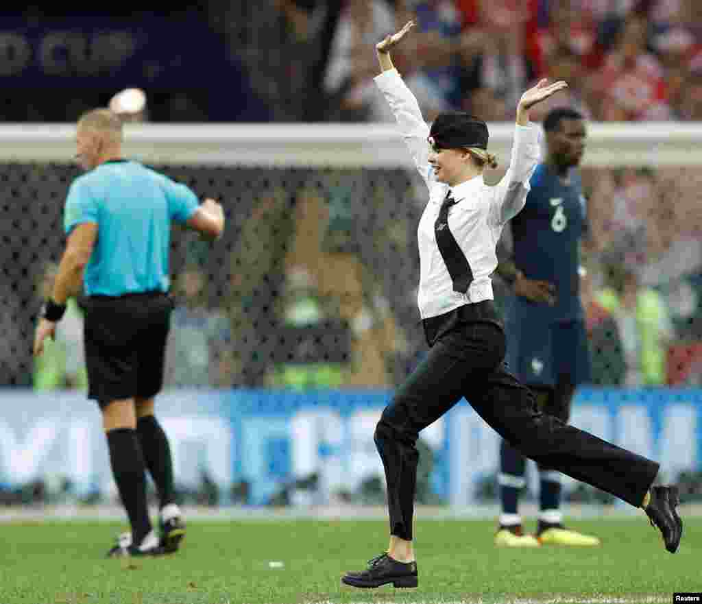 "Pussy Riot claimed responsibility for the pitch invasion, tweeting: ""Just a few minutes ago four Pussy Riot members performed in the FIFA World Cup final match — 'Policeman enters the Game.'"""