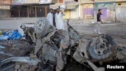 Жарылыстан қалған автокөлік қаңқасы. Бағдад, 7 тамыз 2013 жыл. (Көрнекі сурет)
