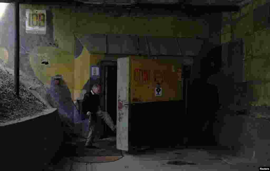 Milan Skocovsky opens a 6.5-ton door to the bunker.