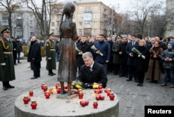Ukrainian President Petro Poroshenko visits a monument to Holodomor victims in Kyiv in November 2016.