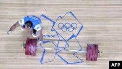 Тяжелоатлет Илья Ильин на Олимпийских играх 2012 года в Лондоне.