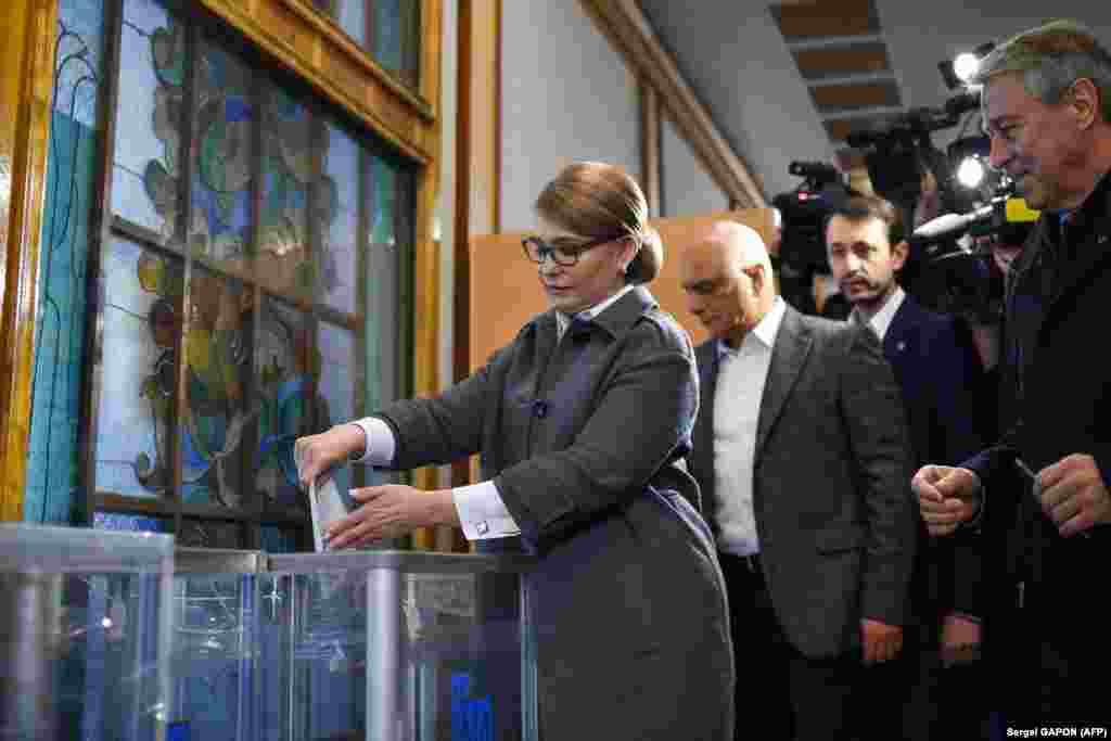 Former Ukrainian Prime Minister and presidential candidate Yulia Tymoshenko casts her ballot at a polling station in Kyiv. (AFP/Sergei Gapon)