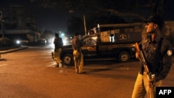 Pakistani police at a security checkpoint on February 17 in Karachi, where security forces captured Mullah Abdul Ghani Baradar.