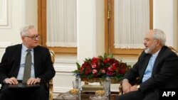 Сергій Рябков (л) і Могаммад Джавад Заріф (п), фото початку 2015 року, під час переговорів щодо укладення ядерної угоди