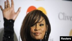 Whitney Houston attended the Pre-Grammy Gala & Salute to Industry Icons in Beverly Hills on February 12.