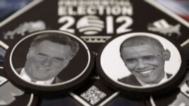 Chocolates with the faces of US President Barack Obama (R) and US Republican presidential candidate Mitt Romney are displayed in a chocolate box in Paris, 12Oct2012