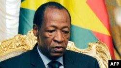 Burkina Faso -- Burkina Faso's President Blaise Compaore waits prior to meeting relatives and acquaintances of the victims of the Air Algerie crash at the Presidential Palace in Ouagadougou, July 26, 2014