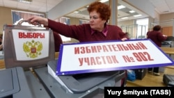 An official prepares ballot boxes in Vladivostok for the March 18 presidential election.