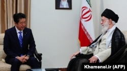 Iranian Supreme Leader Ayatollah Ali Khamenei (right) meets with Japanese Prime Minister Shinzo Abe in Tehran on June 13.