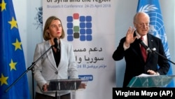EU foreign policy chief Federica Mogherini (left) and UN Special Envoy for Syria Staffan de Mistura talk to journalists in Brussels on April 24.