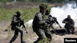 Polish Army soldiers take part in a NATO military exercise in June 2016.
