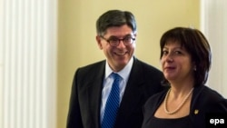 U.S. -- US Treasury Secretary Jack Lew and Ukrainian Finance Minister Natalie Yaresko (R) walk at the Treasury Department in Washington, March 16, 2015