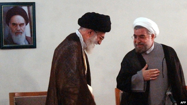 Supreme leader Ayatollah Ali Khamenei (left) meets with President-elect Hassan Rohani in Tehran on June 16.