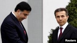 "Грузия Президенти Михаил Саакашвили ва ""Грузия орзуси"" коалицияси лидери Бидзина Иванишвили."