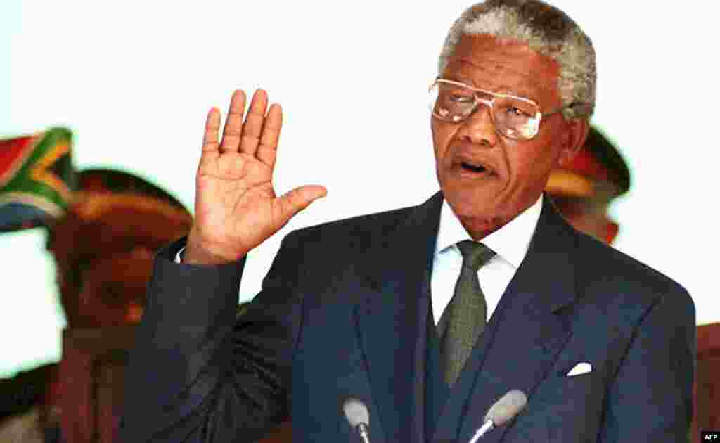 Nelson Mandela takes his oath of office during his presidential inauguration in Pretoria in May 1994.