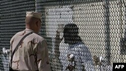 How can the inmates at Guantanamo be tried, and where can they be released?