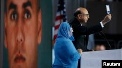 Khizr Khan, whose son Humayun was killed fighting for the U.S. in Iraq, speaks to the Democratic National Convention in Philadelphia in late July, his wife, Ghazala, standing by his side.