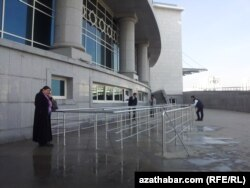 "turkmenistan. people in front of 'ice palace"" in ashgabat"