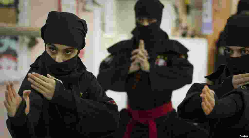 Ninjutsu practitioners from various schools showcase their skills to the media in a gym at Karaj, northwest of Tehran.