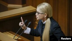 Former Ukrainian prime minister and the leader of Batkivshchyna (Fatherland) party, Yulia Tymoshenko, speaks in parliament on March 29.