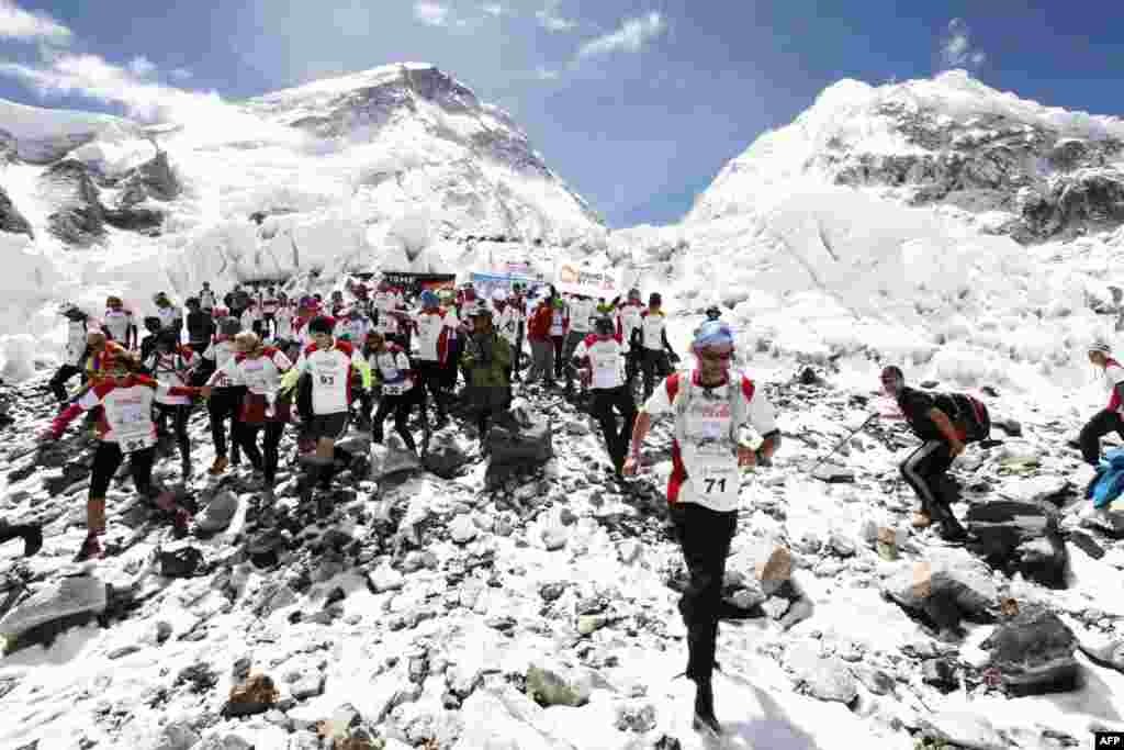 Participants in the Tenzing-Hillary Everest Marathon get the race under way at Everest Base Camp.