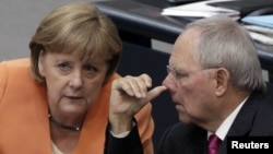 German Chancellor Angela Merkel chats with Finance Minister Wolfgang Schaeuble (file photo)
