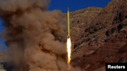 A ballistic missile is launched at an undisclosed location in this handout photo released by Fars news on March 9.