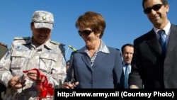 U.S. Ambassador Susan Elliott (center) attends the opening of two new border-guard facilities in Tajikistan. (file photo)