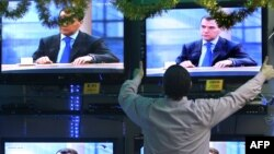 Televisions in a Moscow shop showing an interview with Russian President Dmitry Medvedev in December 2009.